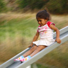How can you go faster down a slide?