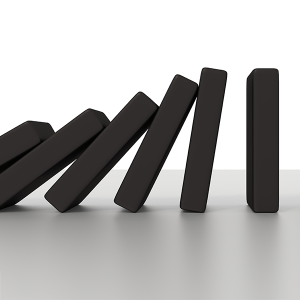 Could you knock down a building using only dominoes?